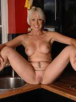 British blonde milf pornstar Tracy Venus gets naked in her kitchen