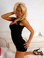 British blonde milf pornstar Tia Layne looks stunning in a black minidress and heels