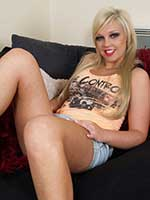 Gorgeous British pornstar Scarlett Lovatt strips from denim skirt and heels to show you her pussy