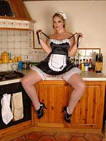 Sexy British pornstar Shay Hendrix dresses in a French Maids uniform and white fishnet stockings